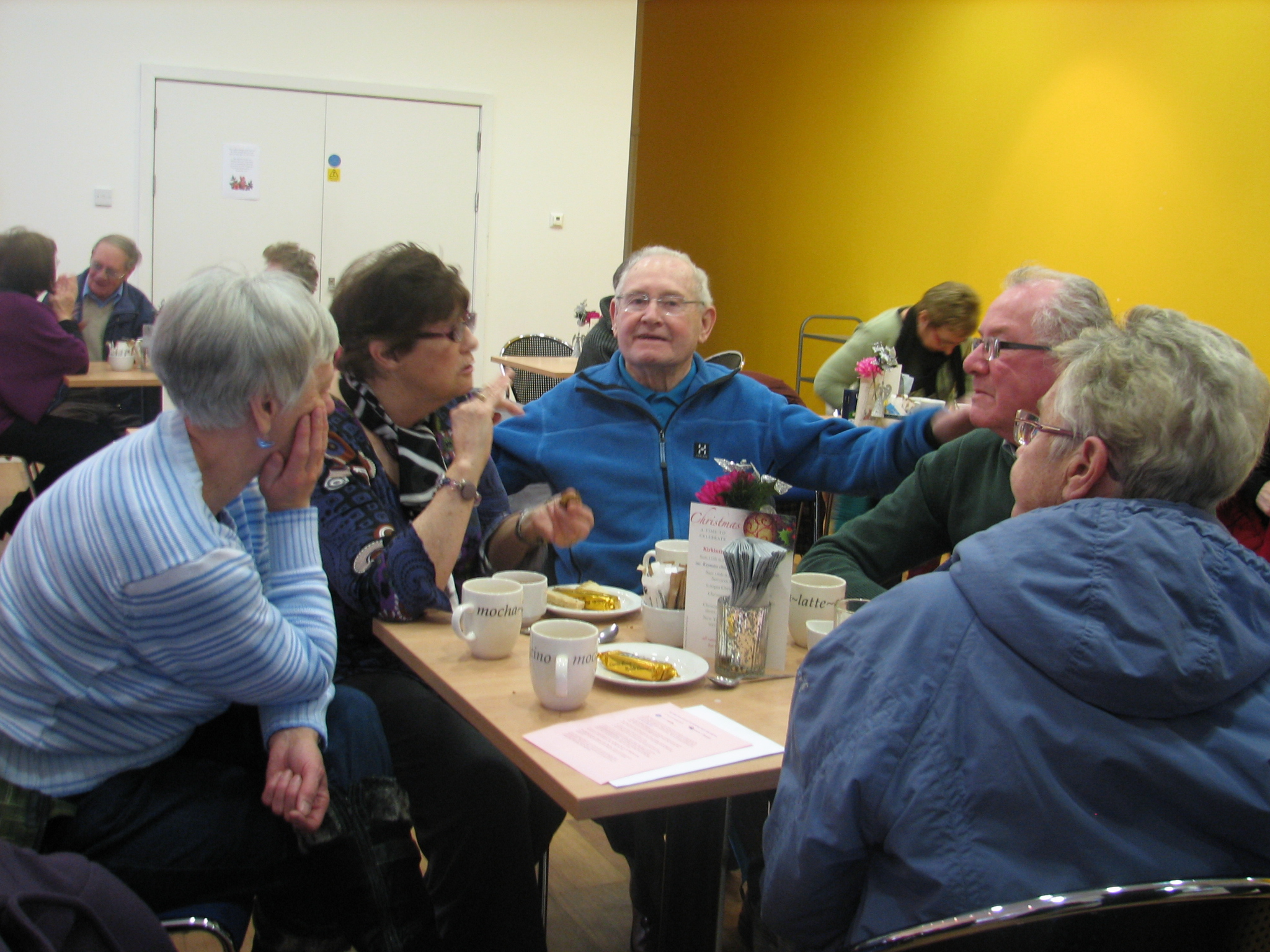People with dementia and their carers at a meeting.