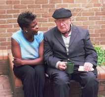 Old man sitting chatting with young woman