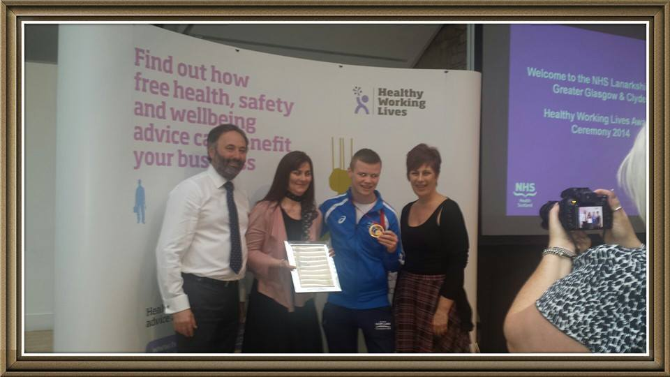 Patricia, Charlie Flynn and Sharon with Healthy Working Lives Silver Award