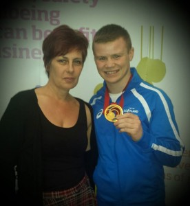 Sharon and Charlie Flynn, with his gold medal