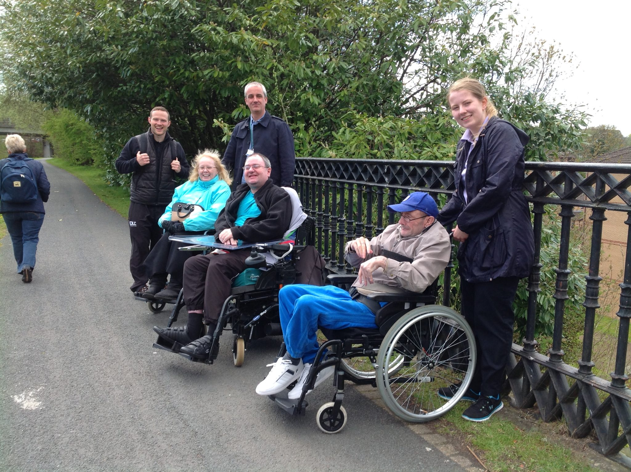 Three wheelchair users and three walkers.