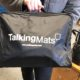 Advocacy worker holding Talking Mats bag