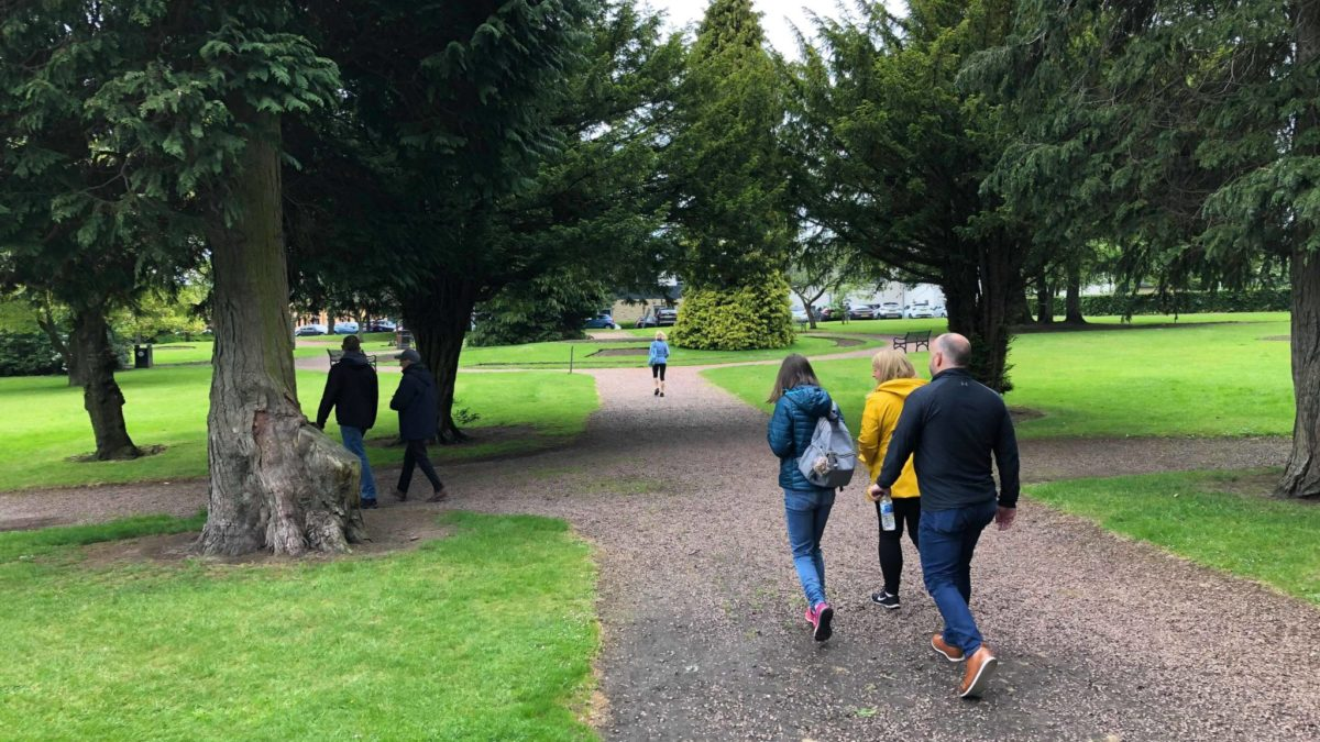 members of Ceartas team walk through the park