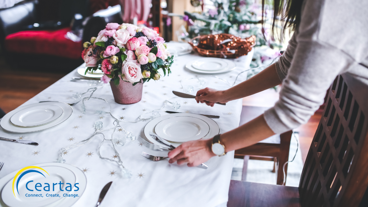 image of woman setting table for dinner