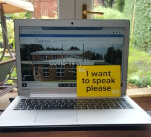 Laptop with Ceartas site and dementia leaflet